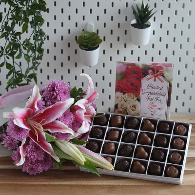 Box of 24 Chocolate Pralines , bouquet of lilies and  chrysanthemum  and congratulations card