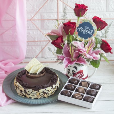 Chocolate almond Dutch truffle cake , Box of 9 Pralines and Arrangement of Red Roses and lilies in a mug with a Blue Women's Day Topper