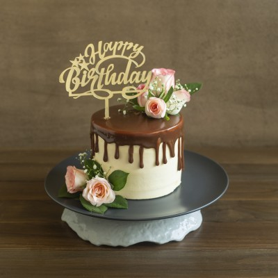 Pure butter almond cake French vanilla butter cream  with Pink Jumelias 900gms with Happy Birtthday Topper