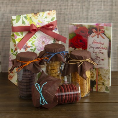 Red velvet cookies, Lavender cookies, Swedish oatmeal cookies and almond biscotti's and a congratulations card