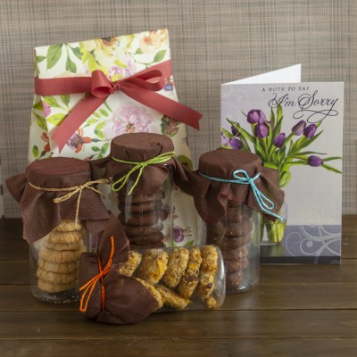 Floral bag with Assorted cookies and a sorry card