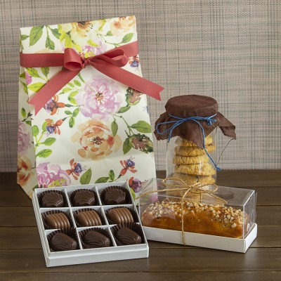 Floral bag with swedish oatmeal cookies ,Almond bar cake ,box of 9 chocolate pralines [Contains Egg]