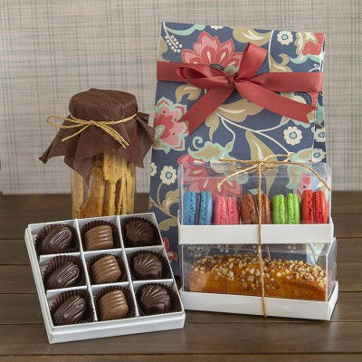 Floral bag with almond biscottis box of 5 macarons ,almond bar cakeand a box of 9 chocolate pralines [Contains Egg]