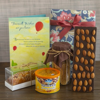 Floral bag with Almond Biscottis, Blue diamond Honey Roasted almonds, Chocolate almond bar ,almond bar cake and a Farewell card [contains Egg]