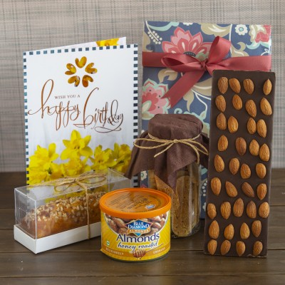 Floral bag with Almond Biscottis, Blue diamond Honey Roasted almonds, Chocolate almond bar ,almond bar cake and a birthday card (contains egg)