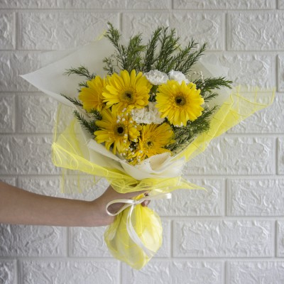 Beautiful Hand Bouquet Of Yellow Gerbaras with White Spray Carnation and Baby Breath