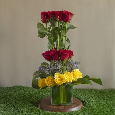 Red and Yellow Roses Arranged in a Square Vase