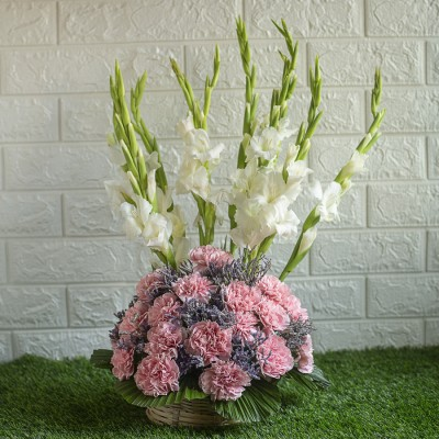 Pink Carnations ,Lavender and Gladiolus in a basket