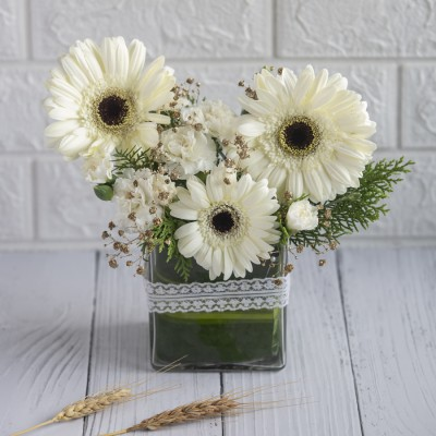 Vase Of White Gerbera's And Carnations