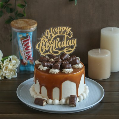 Twix cake with Happy Birthday topper