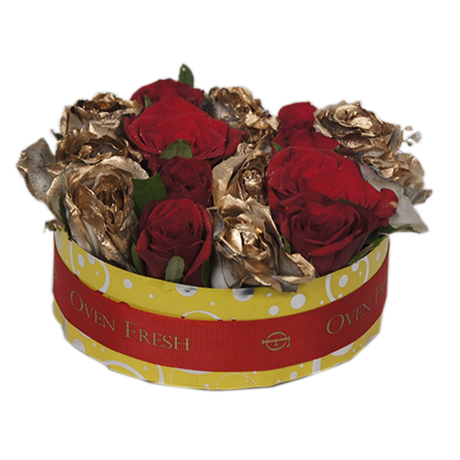 A vase of golden and red roses