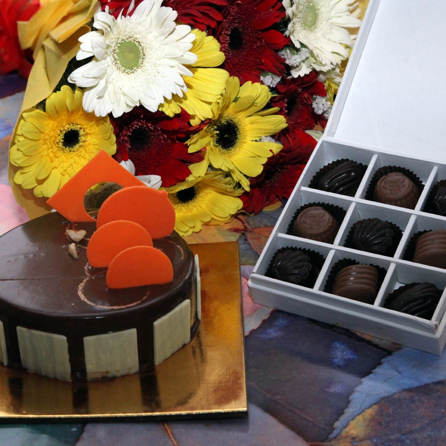 Caramel Panacotta with Hazelnut Chocolate Mousse Cake- 500gms ,hand bouquet and Box of 9 chocolate pralines