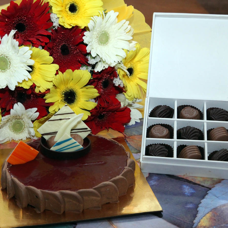 Chocolate crousillant 500gms, Hand Bouquet of Gerbera and Box of 9 chocolate pralines