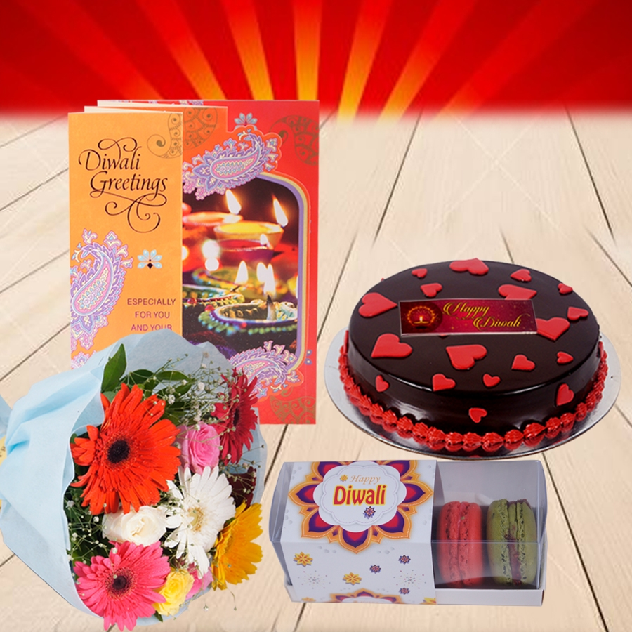 Diwali Dutch Truffle love cake 500gms with Diwali  Card and Bouquet of mixed roses and gerberas and box of 5macarons