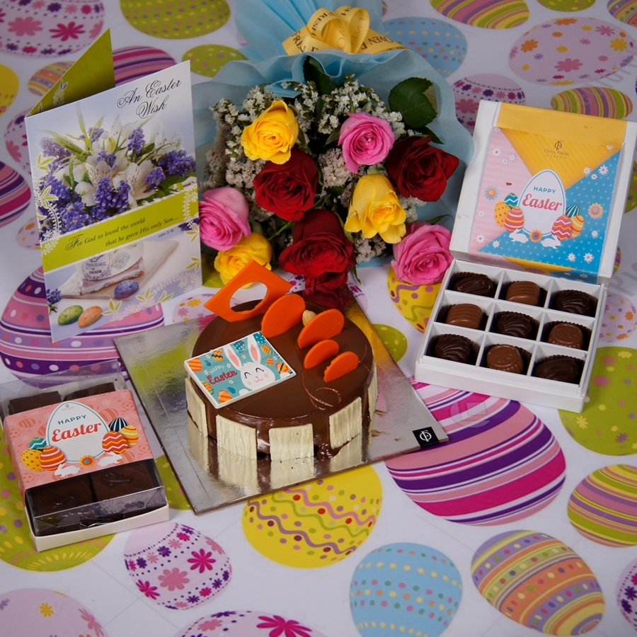 Easter Caramel Panacotta with Hazelnut Chocolate Mousse Cake- 500gms  with card & bouquet of 10 mix roses  & box of 9 chocolate pralines &  box of 6pcs brownies