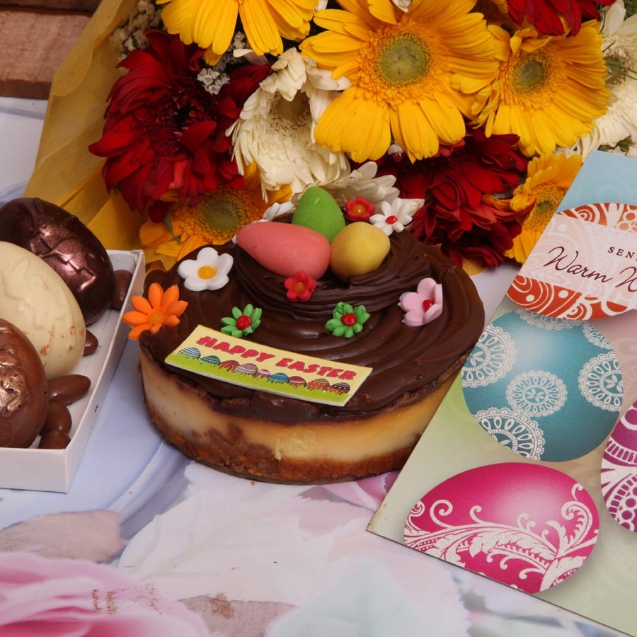 Easter card with  caramel cheese cake 500gms , box of 3 Easter eggs and hand bouquet