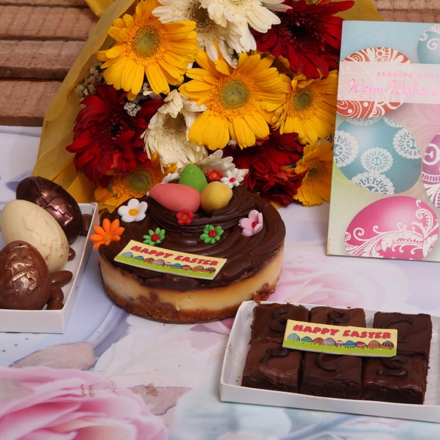 Easter card with  caramel cheese cake 500gms , box of 3 Easter eggs , hand bouquet  and box of 6 brownies