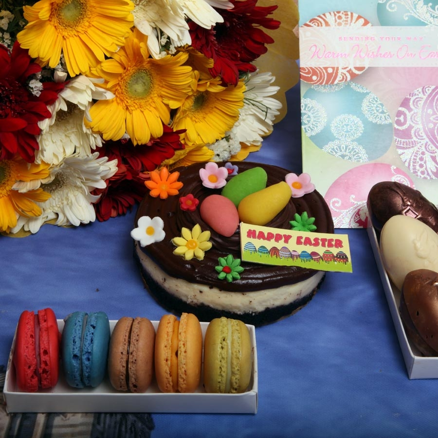 Easter Card with  Chocolate cheese cake 500gms , hand bouquet ,box of 3 easter eggs  and  box of 5macroons