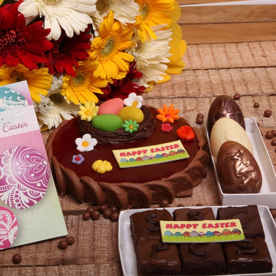 Easter Card with Chocolate Crousillant 500gms ,hand bouquet ,Box of 2easter egg and box of 6 brownies