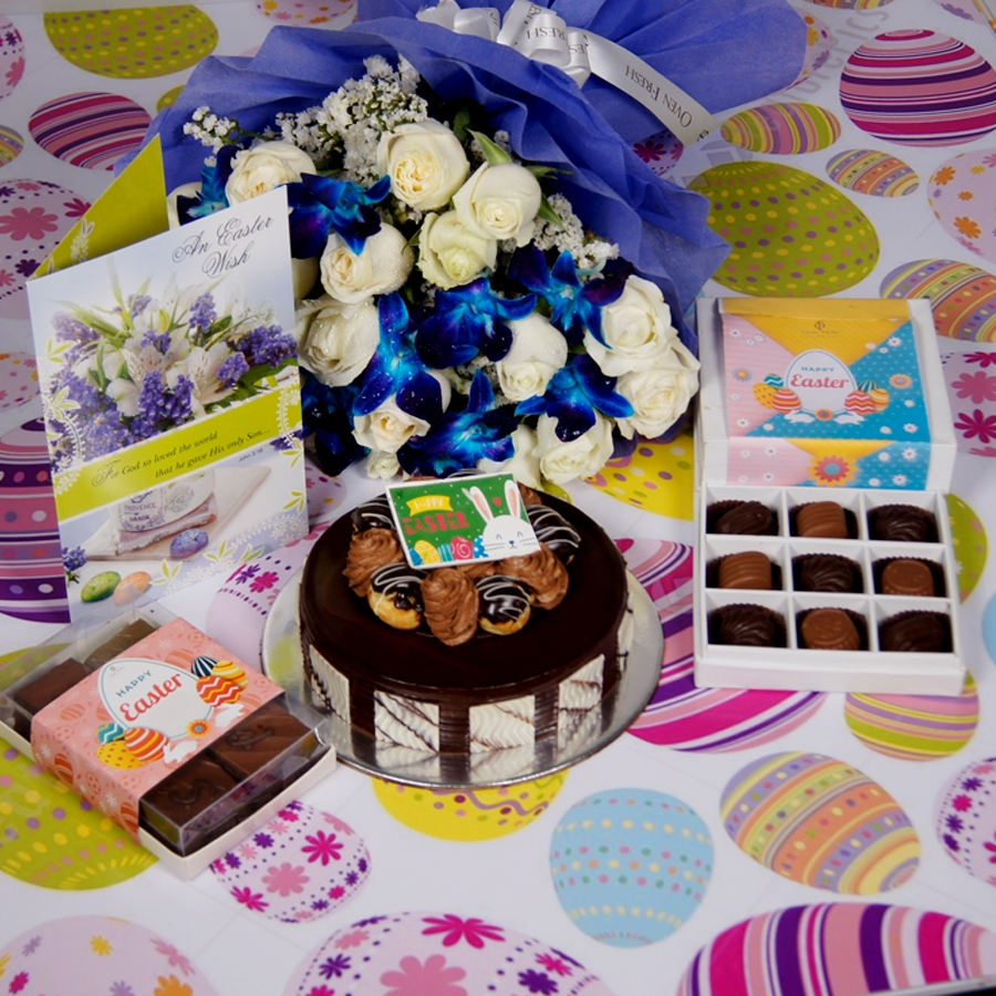 Easter Chocolate dutch truffle with choux buns 500gms Contains Egg with Card & bouquet of white roses and blue orchids & box of 6pc brownies  & box of 9 chocolate pralines .