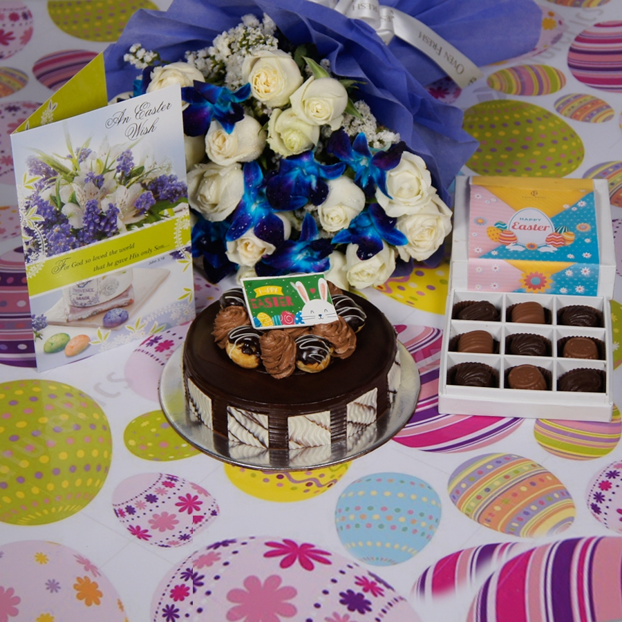 Easter Chocolate dutch truffle with choux buns 500gms Contains Egg with Card & bouquet of white roses and blue orchids  & box of 9 chocolate pralines