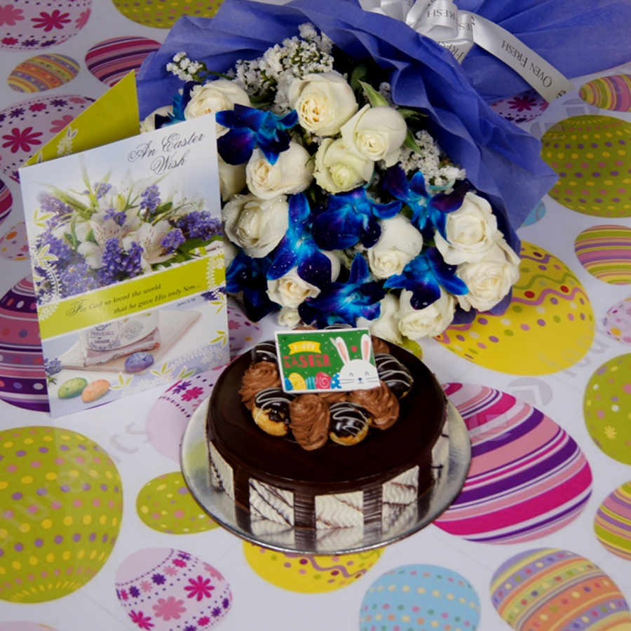 Easter Chocolate dutch truffle with choux buns 500gms Contains Egg with Card & bouquet of white roses and blue orchids
