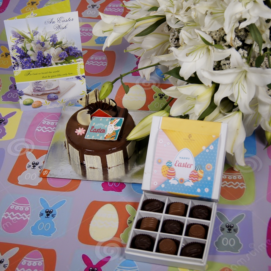 Easter Crunchy Hazelnut with milk chocolate 500gms with Card and a bouquet of white lilies &box of 9 chocolate pralines