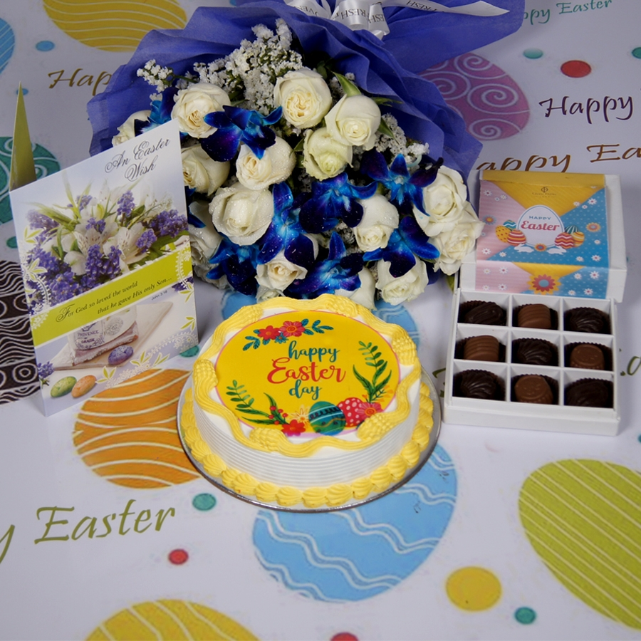 Easter Photo cake yellow Eggless with Card & bouquet of white roses and blue orchids   & box of 9 chocolate pralines