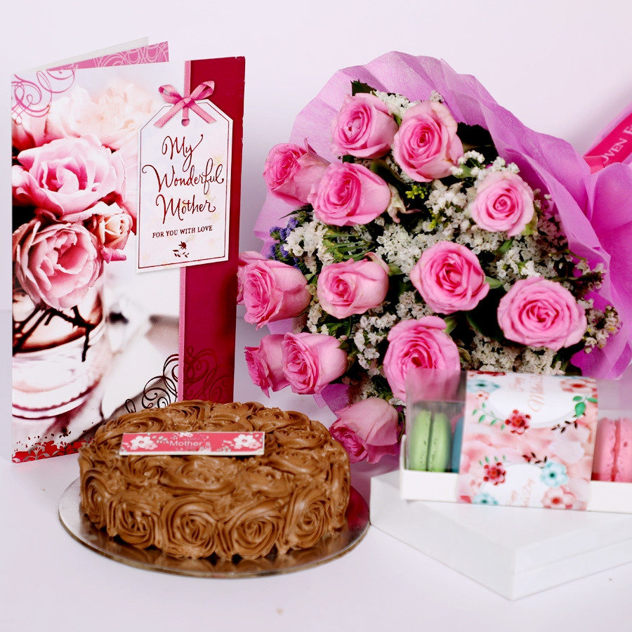 Mothers day Chocolate dutch truffle swirls 500gms with assorted box of 5macarons ,card & bouquet of 15 pink roses