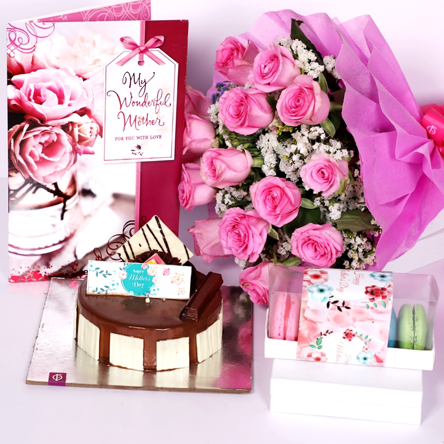 Mothers day Crunchy Hazelnut eggless 500gms with Card and boquet of 15 pink roses & box of 5 macaroons