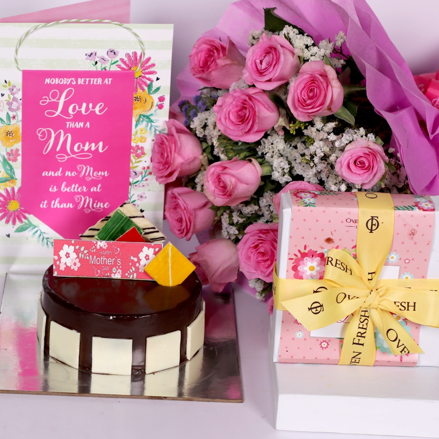 Mothers day Royal Chocolate mousse cake eggless 500gms with card and boquet of 15 pink roses and box of 9pcs chocolate pralines