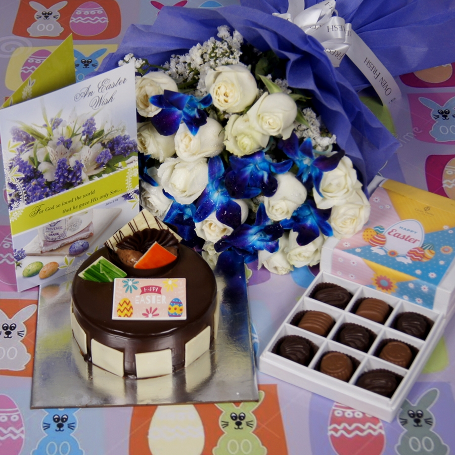 Royale Chocolate Mousse 500gms with card & bouquet of white roses and blue orchids and box of 9 chocolate pralines