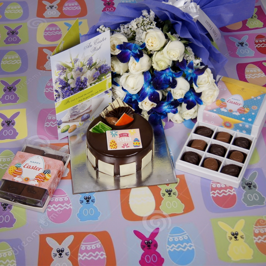 Royale Chocolate Mousse 500gms with card & bouquet of white roses and blue orchids & box of 9 chocolate pralines & box of 6pc brownies.