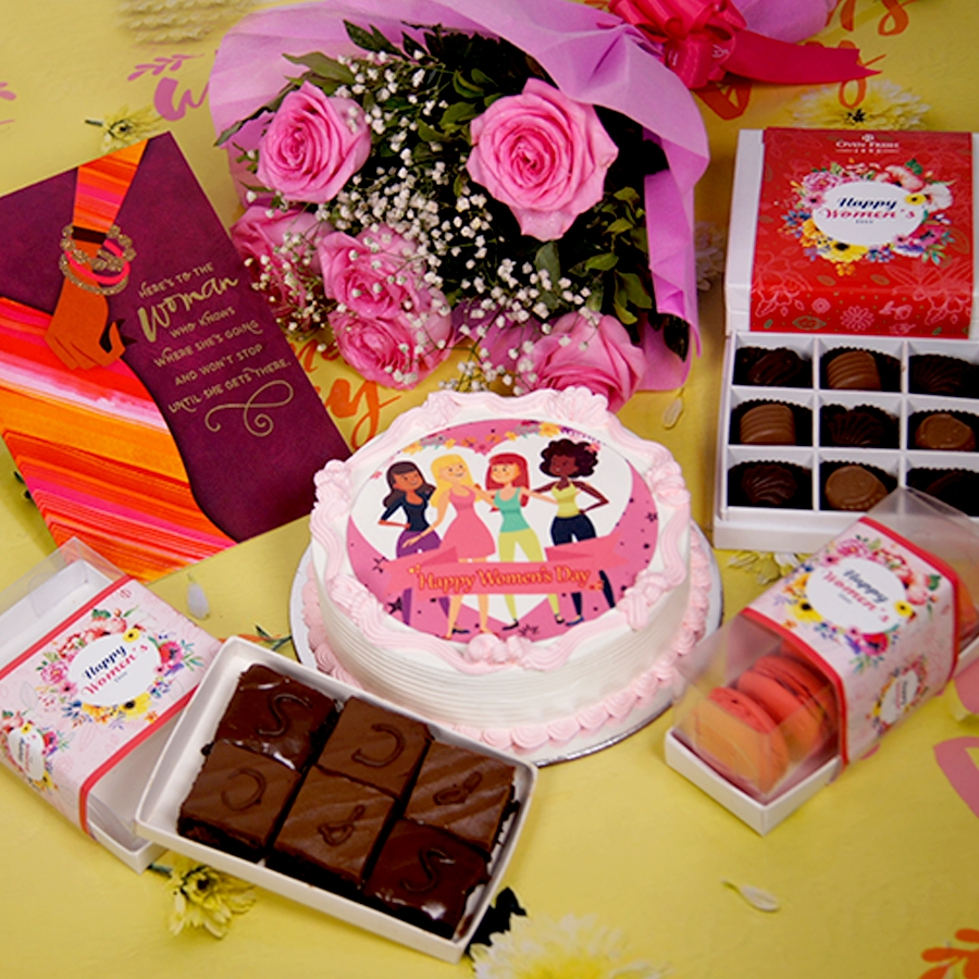 Womens day beauty photo cake 500gms with card ,Bouquet of 6 Pink roses ,box of 9 chocolate pralines , 6 pc assorted Brownie , box of 5 macaroons