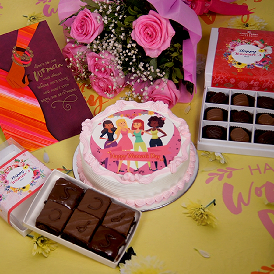 Womens day beauty photo cake 500gms with card ,Bouquet of 6 Pink roses ,box of 9 chocolate pralines , 6 pc assorted Brownie .