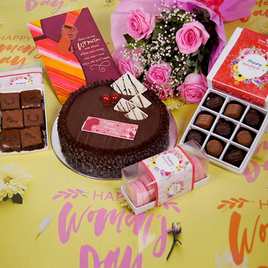 Womens day Chocolate Chip dutch truffle 500gms with card,Bouquet of 6 Pink roses,box of 9 chocolate pralines,box of 6pc brownies,box of 5 macaroons