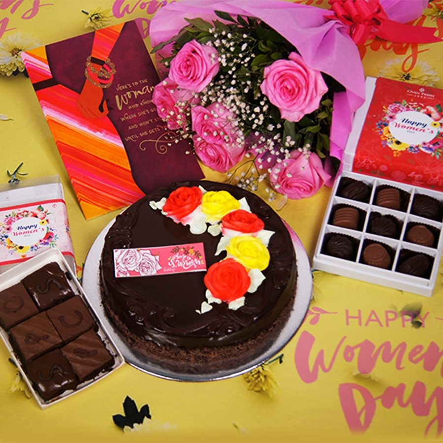 Womens day Chocolate dutch truffle celebration 500gms with card ,Bouquet of 6 Pink roses ,box of 9 chocolate pralines , 6 pc assorted Brownie .