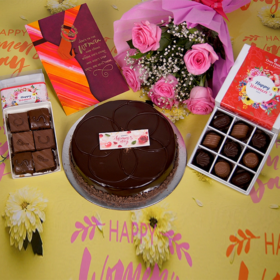 Womens day Chocolate dutch truffle shine  500gms with card,Bouquet of 6 Pink roses,box of 9 chocolate pralines,box of 6pc brownies