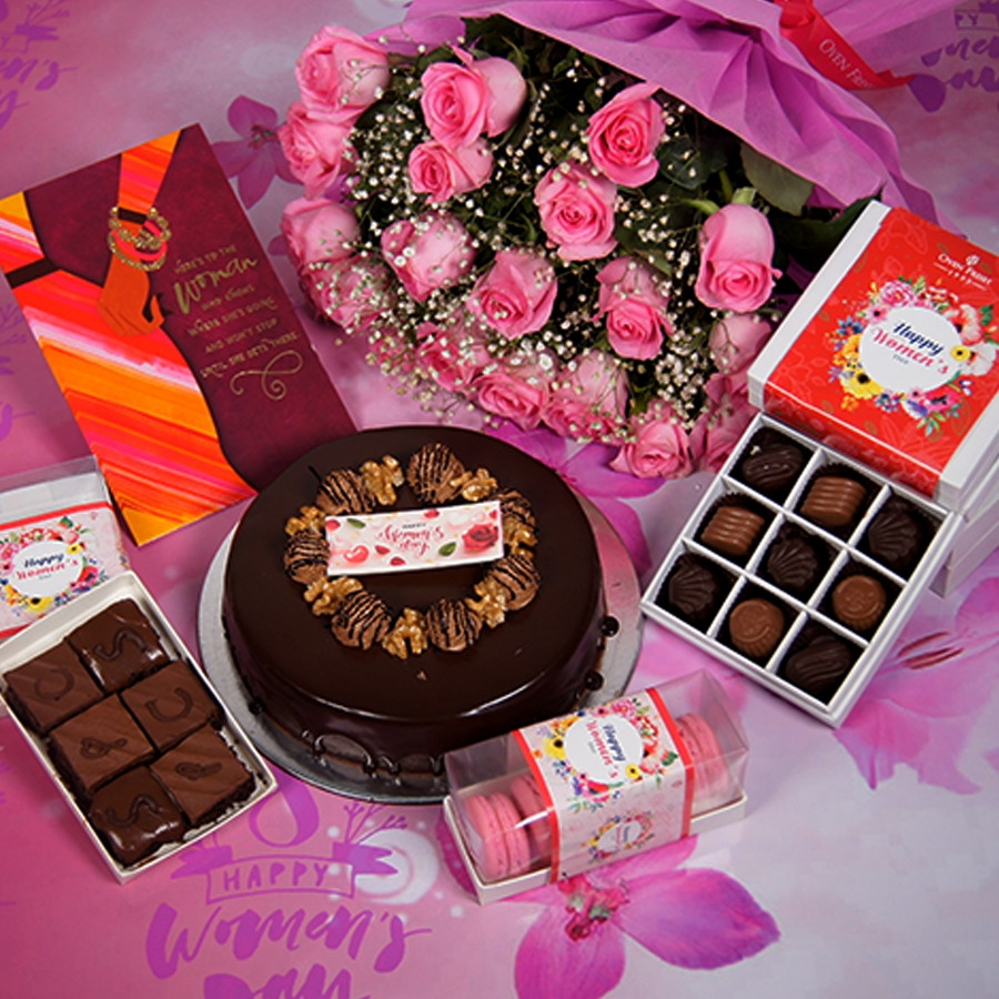 Womens Day Chocolate walnut dutch truffle cake 500gms  with card,Bouquet of pink roses,box of 9 chocolate pralines,box of 6pc brownies,box of 5macaroons