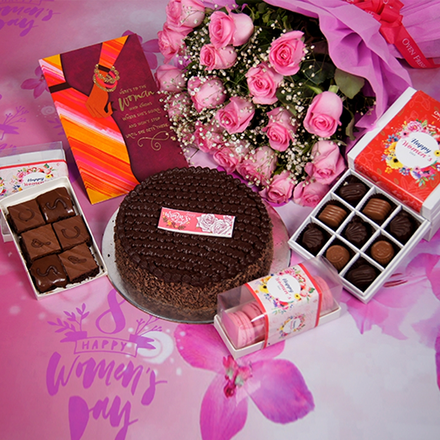 womens Day Dutch truffle classic cake 500gms With Card & Bouquet of Pink Flower & 9 Box Chocolate Pralines & Box of  6pc brownies & box of 5 macaroons