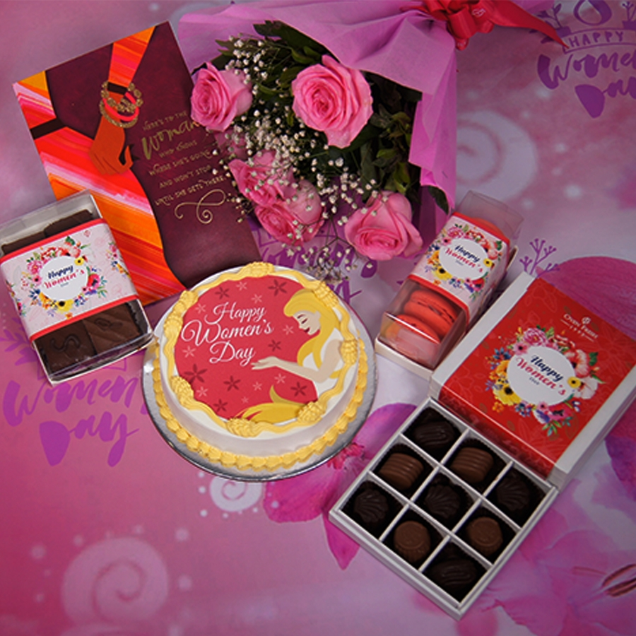 Womens day red and yellow photo cake 500gms with card ,Bouquet of 6 Pink roses ,box of 9 chocolate pralines , 6 pc assorted Brownie and box of 5macaroons