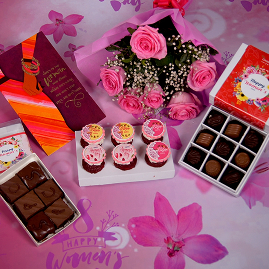 Women's day special  6 pcs red velvet  cup cakes , Greeting card , box of 9 chocolate pralines, 6pcs of assorted brownies & a hand bouquet of 6 pink roses