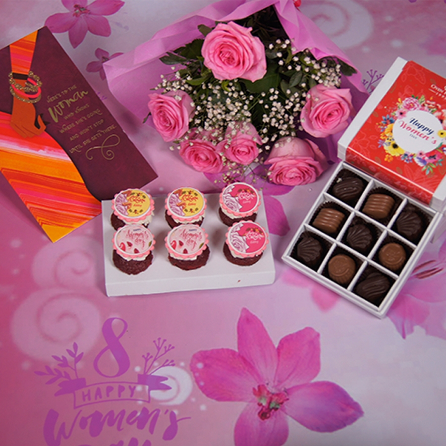 Women's day special  6 pcs red velvet  cup cakes , Greeting card , box of 9 chocolate pralines & a hand bouquet of 6 pink roses